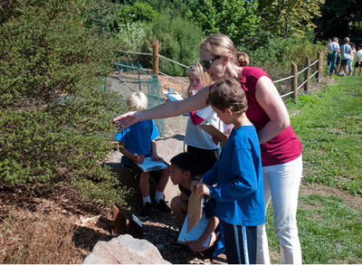 Docent leading a lesson at the Oak School native garden